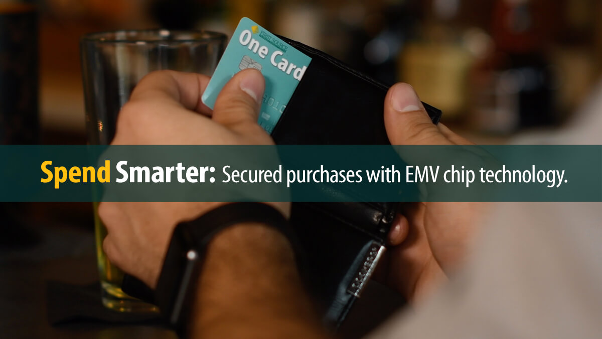 Using a First Source debit card with EMV chip to make purchases.